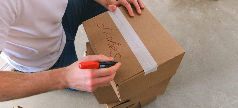 Man labeling boxes