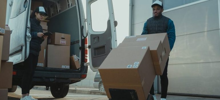 movers unloading a van